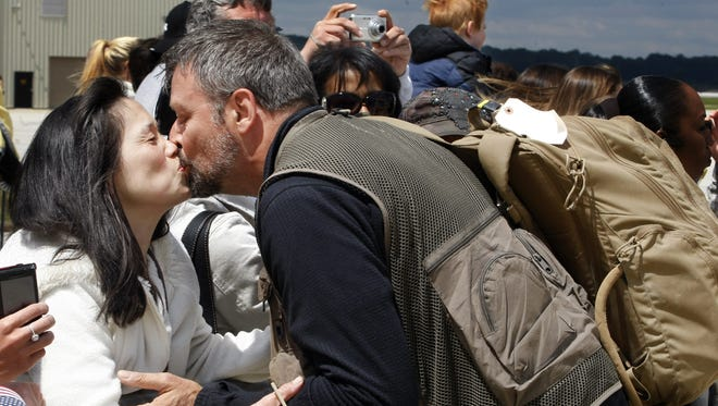 Leaf-Chronicle military affairs reporter Philip Grey receives a kiss from his wife, Patricia, after returning from Afghanistan in May 2011. Grey was embedded with the 101st Airborne Division.