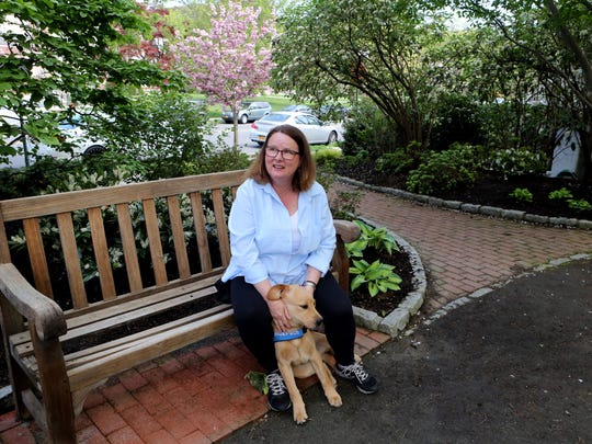 Puppy-raiser Pat Carforo works in Bronxville with JP,
