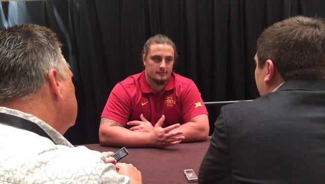 Reporters interview Iowa State center Tom Farniok at the Big 12 Conference Media Days in Dallas