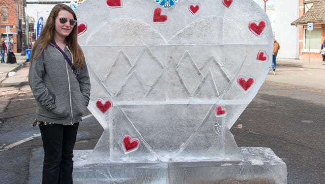 Grace in front of a custom carved ice sculpture at the Loveland Fire and Ice Festival on February 13th, 2016 (Luke Walker/ For The Coloradoan)