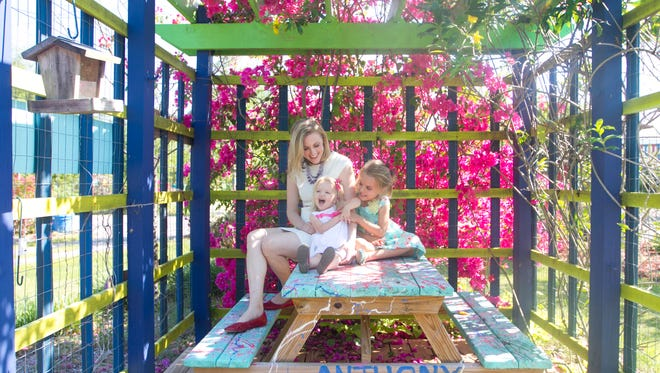 Janine Zeitlin with her two daughters, Violette and Adeline at Artful Gardens in Buckingham.