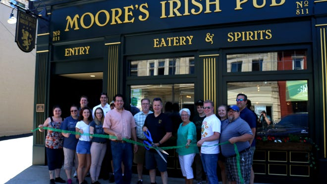 Moore's Irish Pub in Manitowoc cut the ribbon on its new beer garden and expanded menu June 23. Pictured are: Tim Moore, Tom Moore, Kay Moore, Sandy Moore, Carson Moore and Madison Moore, and employees Heather Nelson, Corey Hamachek, Sarah Myers, Malachia Dabeck and special guests Mayor Justin Nickels, aldermen Eric Sitkiewitz and Scott McMeans, Manitowoc Area Visitor & Convention Bureau President Jason Ring and Investors Community Bank CEO Tim Schneider.