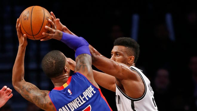 Brooklyn Nets forward Thaddeus Young defends Detroit Pistons guard Kentavious Caldwell-Pope on Feb. 1, 2016, in New York.
