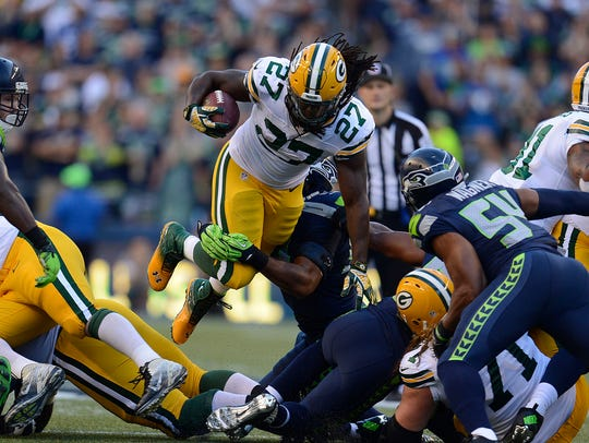 Green Bay Packers running back Eddie Lacy (27) leaps over the line while making a run Sept. 4, 2014, against the Seattle Seahawks at CenturyLink Field in Seattle, Wash.