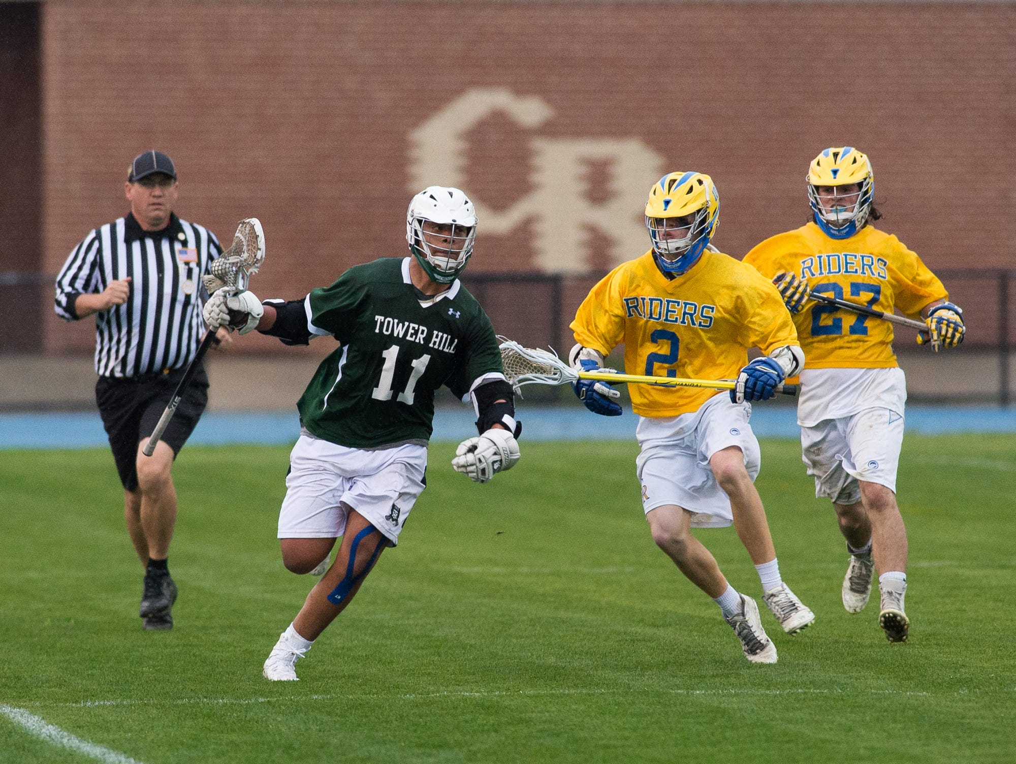 Tower Hills Noah Thomas (11) runs down the side line away from Caesar Rodney's players in their 11-9 win.