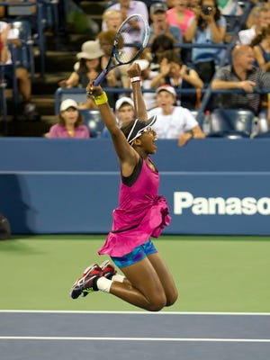 Victoria Duval of the USA, who is 17, leaps in celebration after defeating Samantha Stosur.