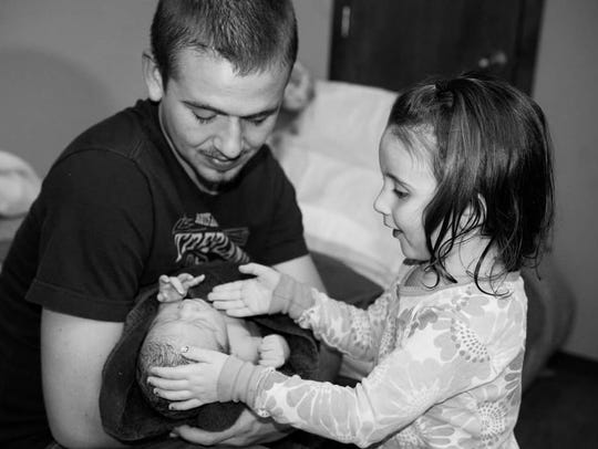 Daniel Shaver and his daughter Natalie welcoming Emery