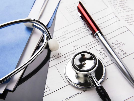 Health care billing statement with stethoscope