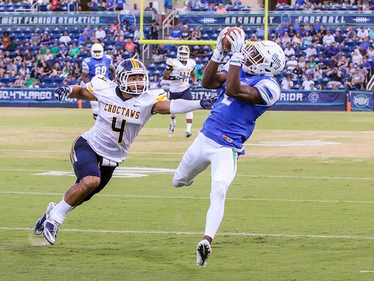 UWF's Rodney Coates (2) beats Mississippi College's Blake Miller (4) and comes down with a first down catch at Blue Wahoos Stadium on Friday, Oct. 6, 2017.  The football program is one of the many reasons the college is celebrating a banner year.
