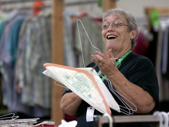 Volunteer Jan Vaughn works with a smile at Rust Street Ministries. Volunteers help the organization meet its goals of providing food, clothing, furniture, household items and spiritual counsel to everyone free of charge.