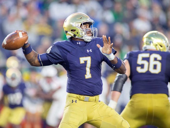 Notre Dame Fighting Irish quarterback Brandon Wimbush (7) passes the ball in the second half of the game against the Miami (Oh) Redhawks at Notre Dame Stadium.