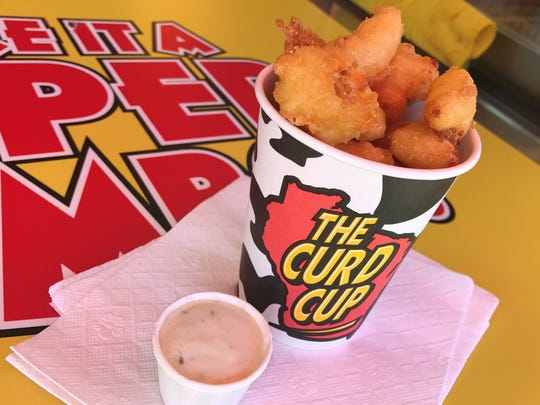 A cup of deep-fried cheese curds with jalapeno ranch dip at the 2018 Indiana State Fair.