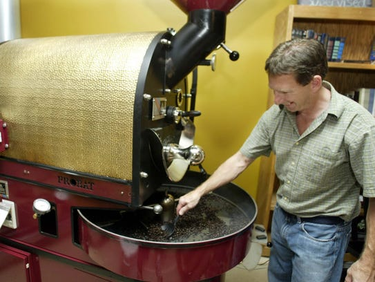 Mugsy's Coffee Shop owner Ray Huot prepares a batch