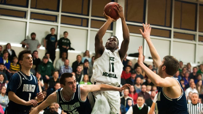 Rice's Ben Shungu (11) leaps to take a shot during the boys basketball game between the Burlington Seahorses and the Rice Green Knights on Tuesday night in South Burlington.