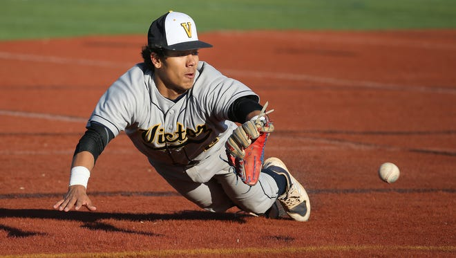 Victor shortstop Santino Rosso makes a diving stop in the hole but can't throw out Schroeder's Jack Willard.