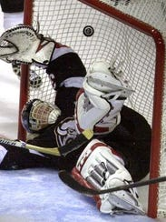 Dominik Hasek makes a sprawling save