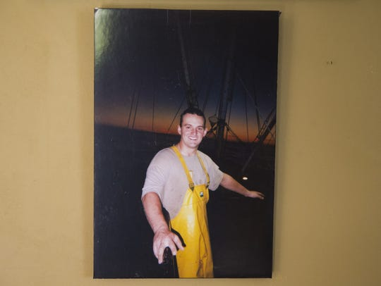 Photo of Keith Davis hanging in his father's home.