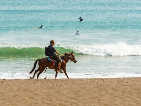 Man on the horse in Playa Venao near town of Pedasi