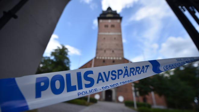 A picture taken on July 31, 2018 shows a cordoned zone as Swedish police investigate after Sweden's royal jewels dated from the 17th century were stolen from the Strängnäs cathedral, west of Stockholm.