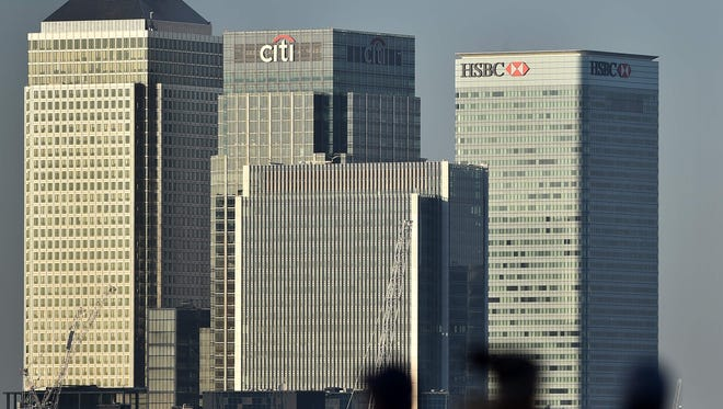 File photo taken in 2015 shows United Kingdom headquarters of HSBC (right) at Canary Wharf in London.