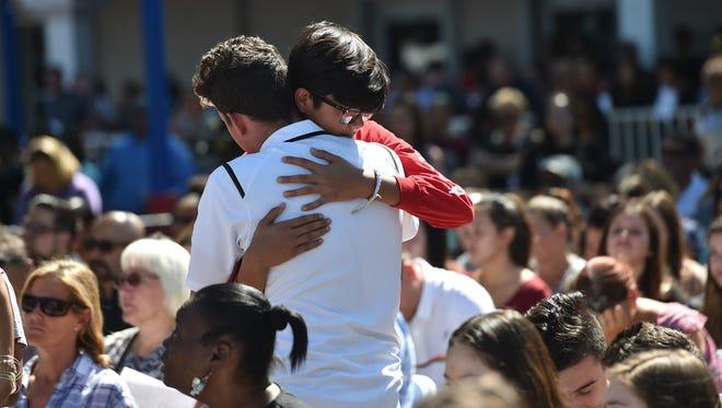 Hundreds gather at Parkridge Church in Coral Springs on Thursday, Feb. 16, 2018, for community prayer vigil for Marjory Stoneman Douglas High School shooting victims.