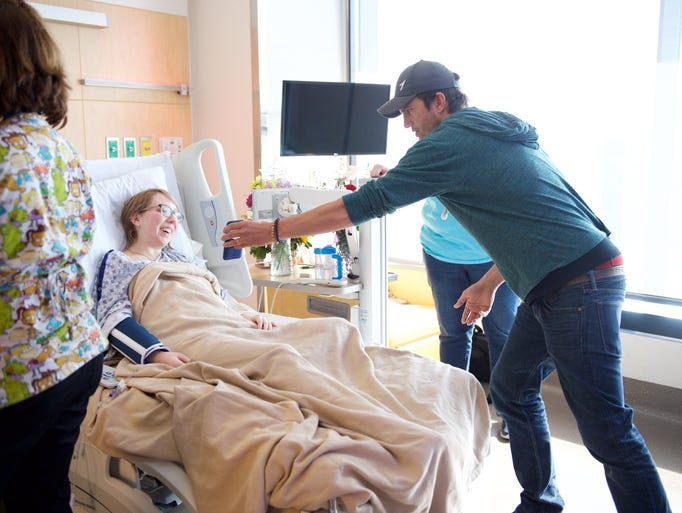 Ashton Kutcher meets with patients at the University