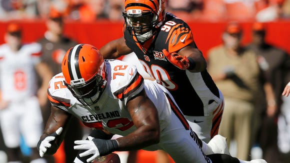 """Cleveland Browns offensive tackle Shon Coleman (72) dives for a loose ball against Cincinnati Bengals defensive end Michael Johnson (90) in the fourth quarter of the NFL Week 4 game between the Cleveland Browns and the Cincinnati Bengals at FirstEnergy Stadium in downtown Cleveland on Sunday, Oct. 1, 2017. The Bengals tallied their first win of the season, 31-7, in the """"Battle for Ohio"""" game."""