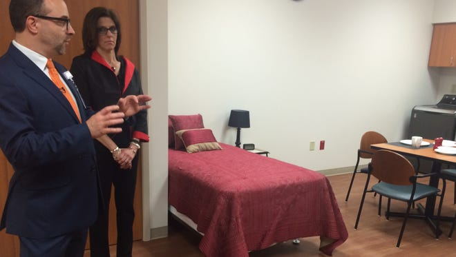 """Officials of the new TriHealth Rehabilitation Hospital at I-71 and Dana Avenue show off the """"Activities of Daily Living"""" room at the new facility. TriHealth and Select Medical of Mechanicsburg, Pennsylvania, together own the new facility."""