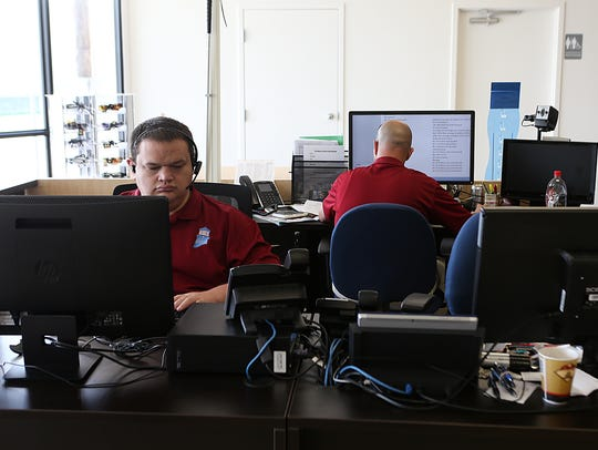 Employees Canyon Sullivan (left) and Manual Zavala work at the newly opened Lighthouse Office Supply, 1953 Austin St., operated by the West Texas Lighthouse for the Blind, on June 13, 2018.
