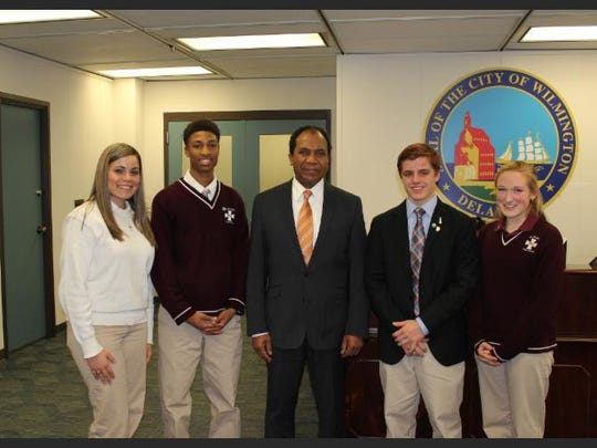To honor the 183-year history of Catholic schools in the City of Wilmington, Dennis P. Williams, mayor of Wilmington, presented the Proclamation for Catholic Schools Week to St. Elizabeth High School students senior Annalis Lopez (from left to right),sophomore Eric Hicks, senior Dominic Vivolo and sophomore Abigayle Gant.