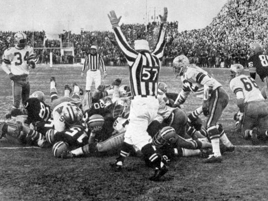 1967 NFL Championship: Bart Starr's quarterback sneak into the end zone with 16 seconds remaining clinched a Packers victory in the Ice Bowl, a title bout played in the most difficult of conditions that became an all-time pro football classic. The win earned the Vince Lombardi-led Packers their fifth NFL championship over seven seasons, including an unprecedented three straight championships from 1965-1967. The Packers -- who own the most championships in NFL history -- would go a long 29 years before winning another title.