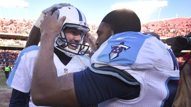 Titans kicker Ryan Succop, left, is congratulated by linebacker Wesley Woodyard (59) after making the winning field goal as time expired Sunday.
