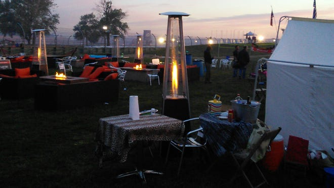 An upscale scene dots the landscape on the infield of Indianapolis Motor Speedway. This is the first year IMS has allowed 'glamping' -- upscale camping for a steeper price.