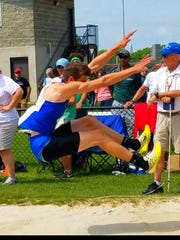Kyle Rollins, shown here long jumping, set personal