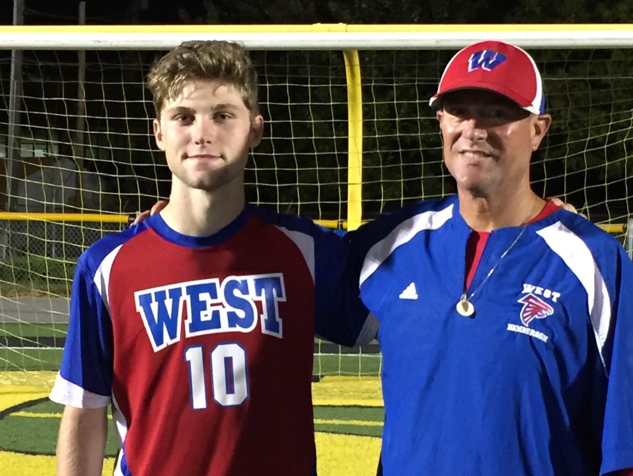 Tyson Hichman and West Henderson boys soccer coach Brian Brewer.