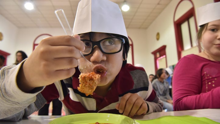 Sahir Baksh 8, eats a meat ball prepared by Healthy lifestyle chef Carlo Filippone at School #5 as part of  Health and Wellness Week in Cliffside Park.