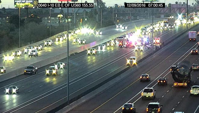 A crash on Interstate 10 in the westbound lanes approaching U.S. 60 snarled rush-hour traffic on Friday morning, Dec. 9, 2016.