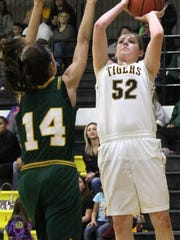 Alamogordo's Kristyn Archuleta puts up a shot while being guarded by Mayfield's Jayce Gorzeman.