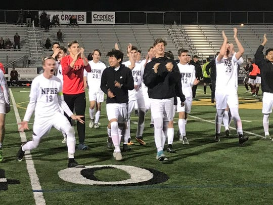 The Newbury Park High boys soccer team celebrates its 5-0 rout of Paso Robles in the first round of the CIF-Southern Section Division 3 playoffs on Friday night.