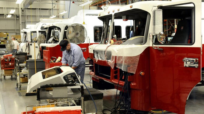 Firetruck cabs are built at Spartan Motors in 2010. The company will build a new manufacturing plant on its Charlotte campus next year — an expansion that's expected to create an estimated 55 new jobs.