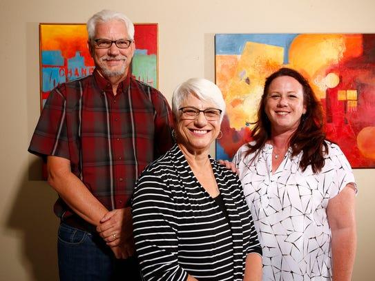 Mike Bull, Jackie Wszalek (center) and Wendy McClellan