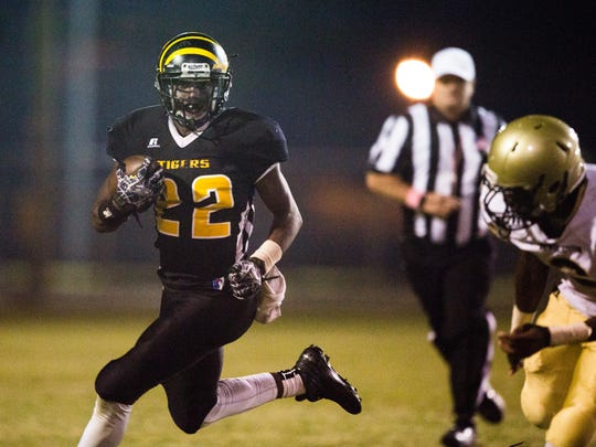 Crescent sophomore Kenny White runs the ball during the Crescent vs. Pendleton game on Friday, October 14, 2016 in Iva.