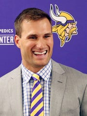 Minnesota Vikings quarterback Kirk Cousins addresses the media March 15 after signing a three-year, $84 million contract.