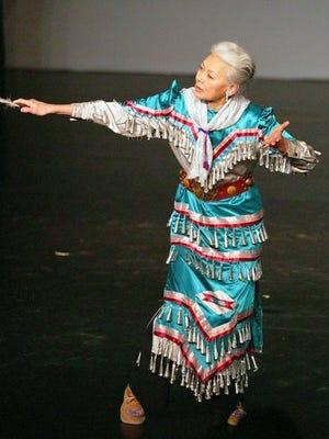Daystar/Rosalie Jones wears a blue jingle dance dress, in which she tells a story of healing.
