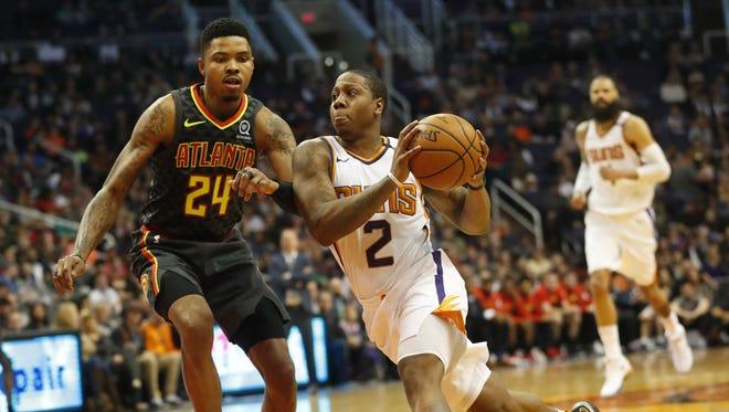 Phoenix Suns guard Isaiah Canaan (2) drives against Atlanta Hawks guard Kent Bazemore (24) during the third quarter at Talking Stick Resort Arena in Phoenix January 2, 2018.