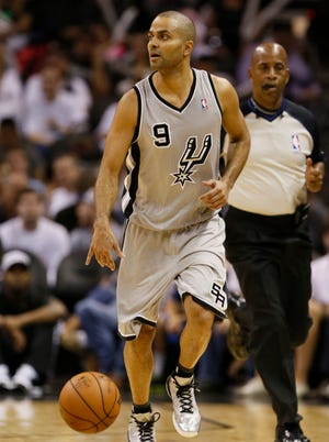 San Antonio Spurs guard Tony Parker (9) brings the ball up court during the second half against the Memphis Grizzlies at AT&T Center.