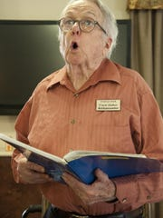 Frank Walker sings for the Visalia Volunteer Singers. They perform at retirement homes around Visalia such as Redwood Springs Healthcare Center on Friday, October 23, 2015.