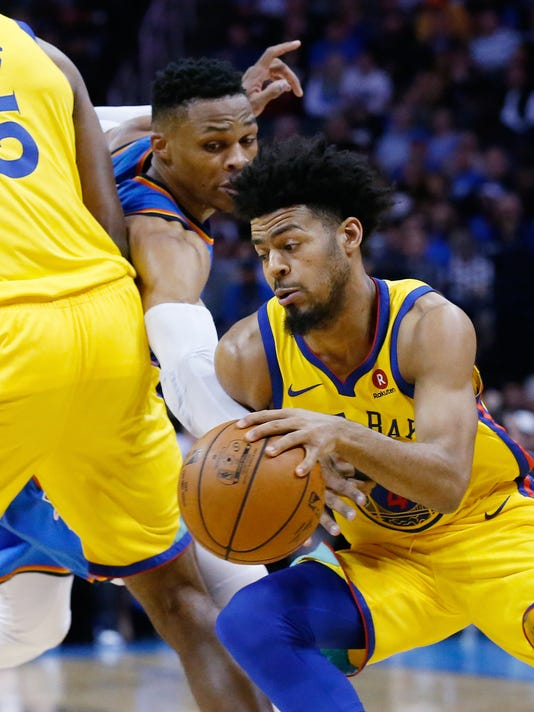 Golden State Warriors guard Quinn Cook, right, drives past Oklahoma City Thunder guard Russell Westbrook, left, during the first half of an NBA basketball game in Oklahoma City, Tuesday, April 3, 2018. (AP Photo/Sue Ogrocki)