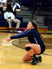 Pope John Paul II High sophomore Reanna McNair digs out a serve during Thursday's match against Wilson Central.