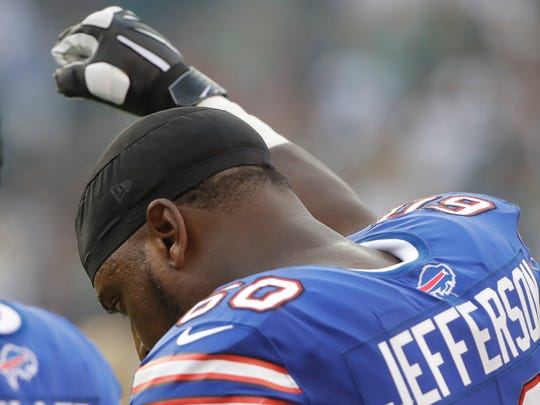 Buffalo's Cameron Jefferson raises his fist during the national anthem before an NFL preseason game.